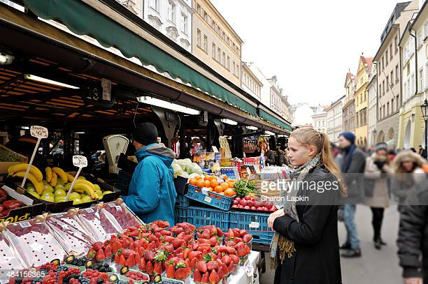 Teenage girl shopping in Farmer's Market in Prague with her father