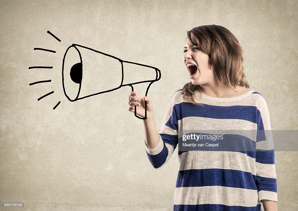 Teenage Girl, shouting in a Megaphone : Stock Photo