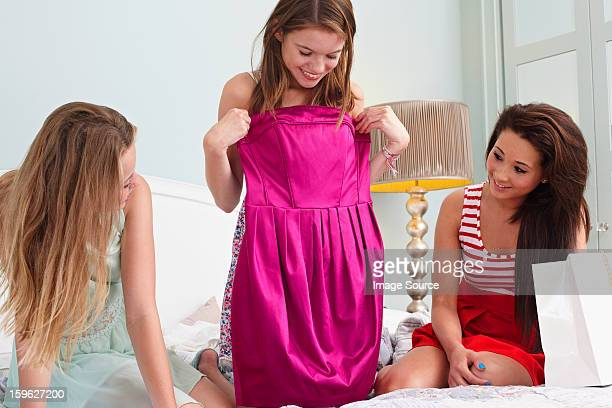 teenage girl showing dress to friends - strapless dress stock pictures, royalty-free photos & images