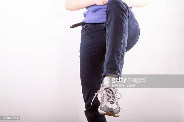 Teenage girl showing her sneaker
