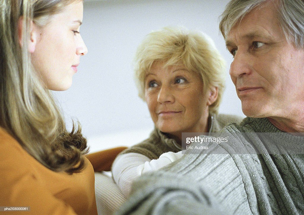 Teenage girl, side view, facing two senior adults, head and shoulders, close-up : Stockfoto