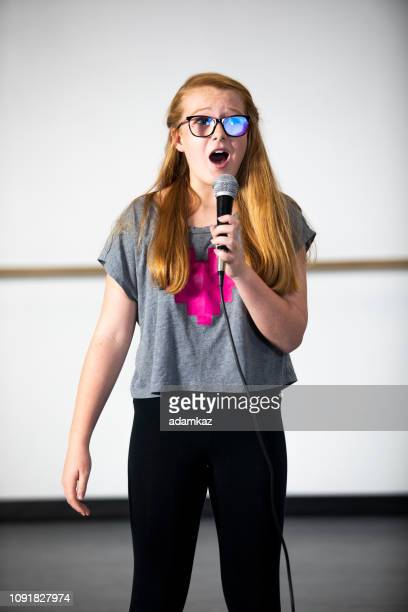 teenage girl singing at musical theatre class - performing arts center stock pictures, royalty-free photos & images