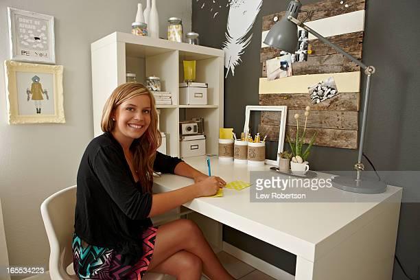 Teenage girl sitting at desk