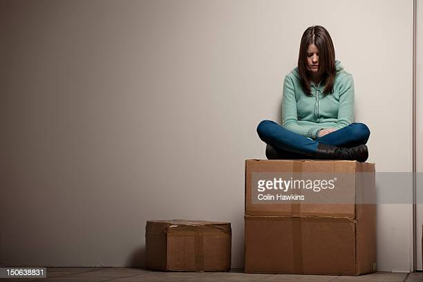 teenage girl sitting on cardboard box - vulnerability stock pictures, royalty-free photos & images