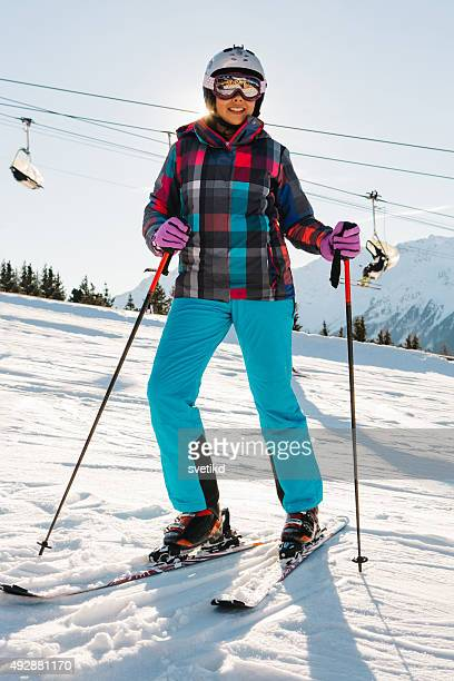 Teenage girl skiing in Italian Alps.