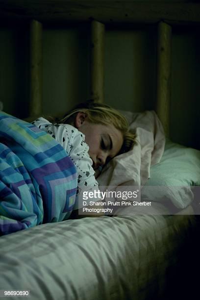 Teenage Girl Sleeping In Dark Room