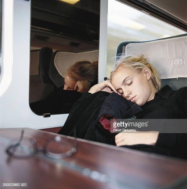 Teenage girl (14-15) sleeping in train