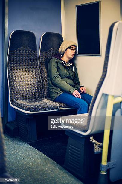 Teenage girl sleeping on the train
