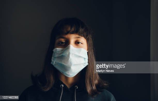 """teenage girl smiling behind the mask - """"marilyn nieves"""" stock pictures, royalty-free photos & images"""