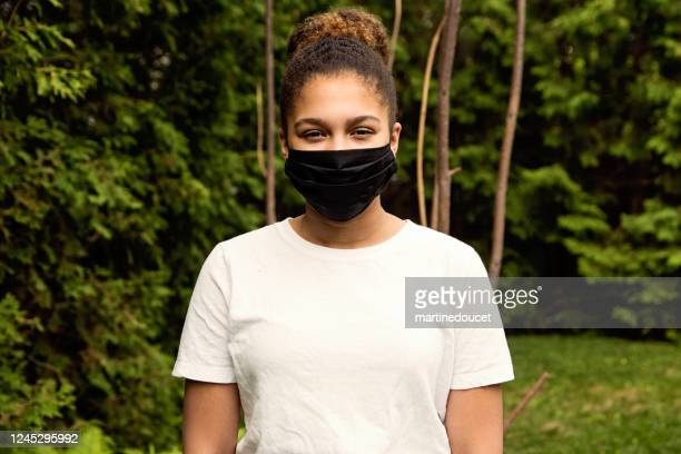 "teenage girl smiling behing stylish protective mask. - ""martine doucet"" or martinedoucet imagens e fotografias de stock"