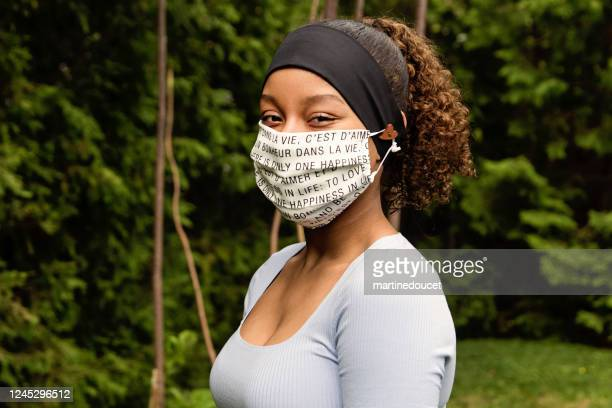teenage girl smiling behing stylish protective mask. - headband stock pictures, royalty-free photos & images