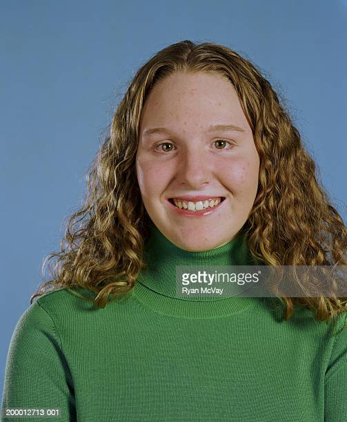 Teenage girl (14-16) smiling, high section, portrait