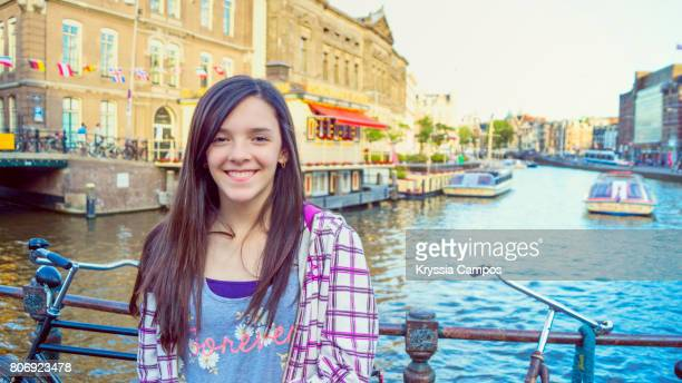 teenage girl smiling in amsterdam, netherlands - riverbank stock photos and pictures