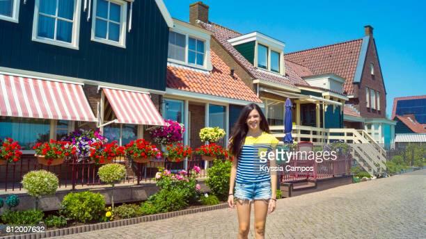 Teenage girl smiling in Volendam, Netherlands