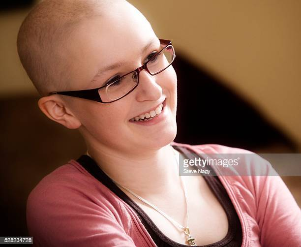 teenage girl smiling - bald girl stock photos and pictures