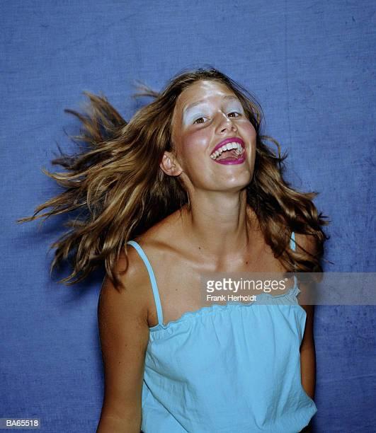 Teenage girl (15-17) smiling, portrait