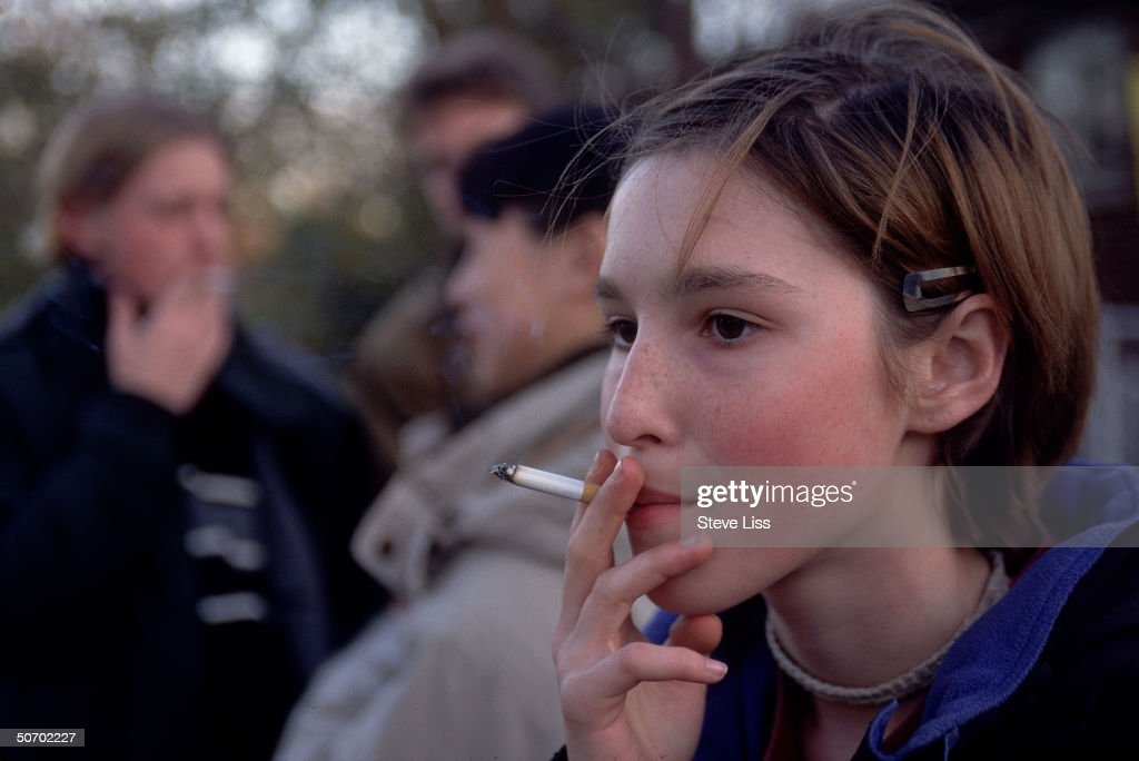 Teenage girl smoking cigarette.  (Photo : News Photo