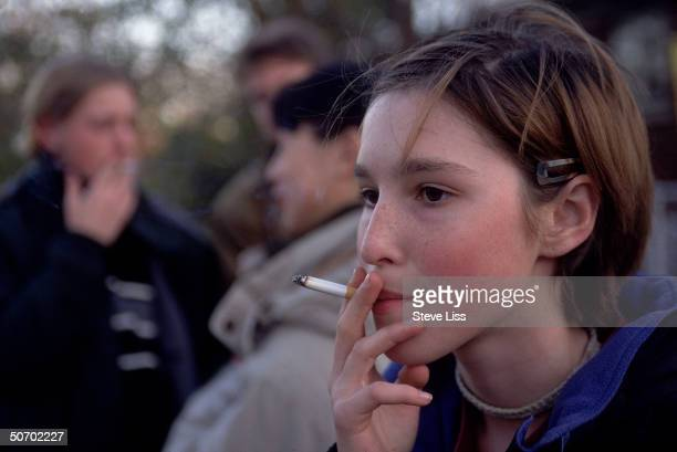 Teenage girl smoking cigarette