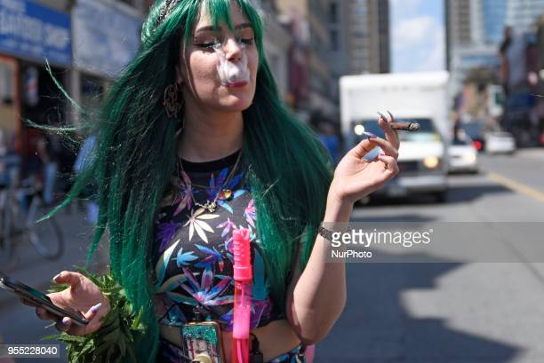 https://media.gettyimages.com/photos/teenage-girl-smoking-up-marijuana-during-the-toronto-global-marijuana-picture-id955228040?s=612x612