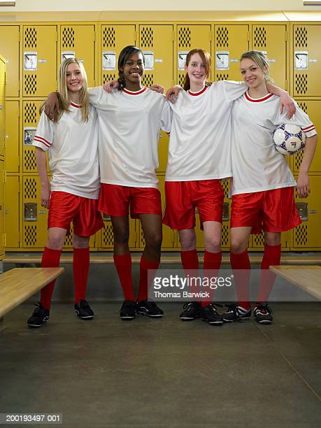 teenage girl (16-18) soccer team in locker room, portrait - high school football stock pictures, royalty-free photos & images