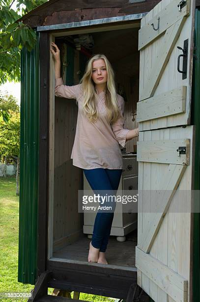Teenage girl standing in doorway