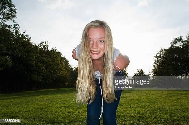 teenage girl standing in field - one teenage girl only stock pictures, royalty-free photos & images