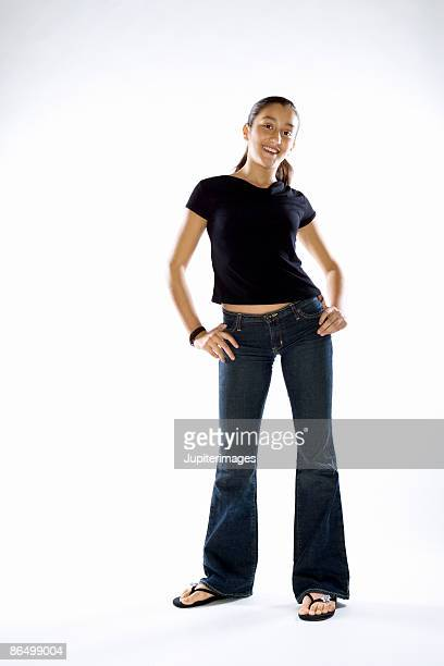 Teenage girl standing with hands on hips