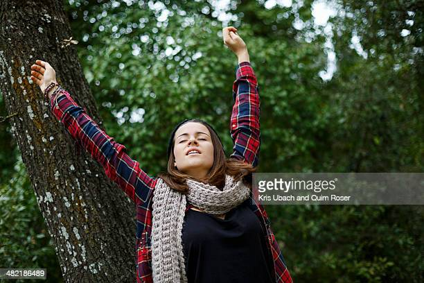 Teenage girl stretching in forest