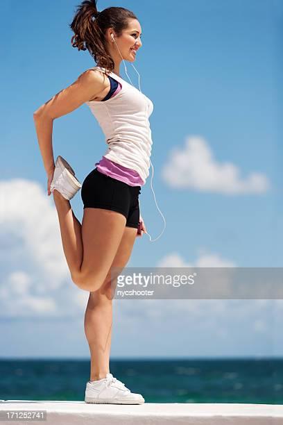 Teenage girl stretching
