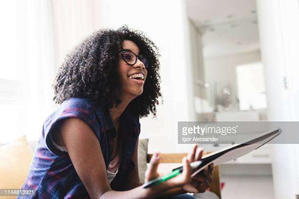 teenage girl studying at home - brace stock pictures, royalty-free photos & images
