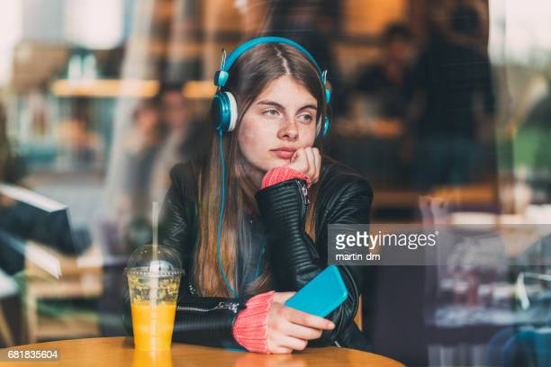 teenage girl studying foreign language - mp3 juices stock photos and pictures