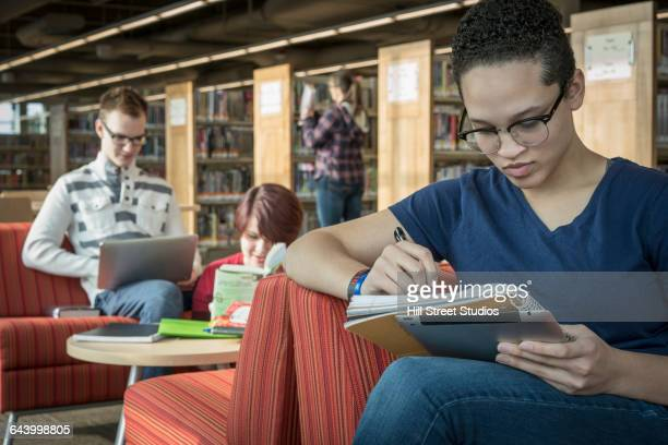 Teenage girl studying in library