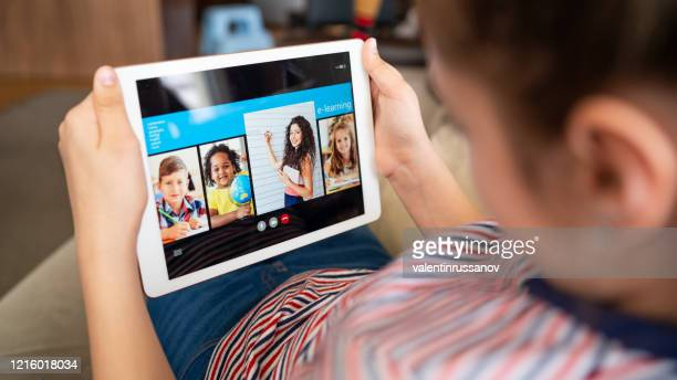 teenage girl studying with video online lesson at home - patients brothers stock pictures, royalty-free photos & images