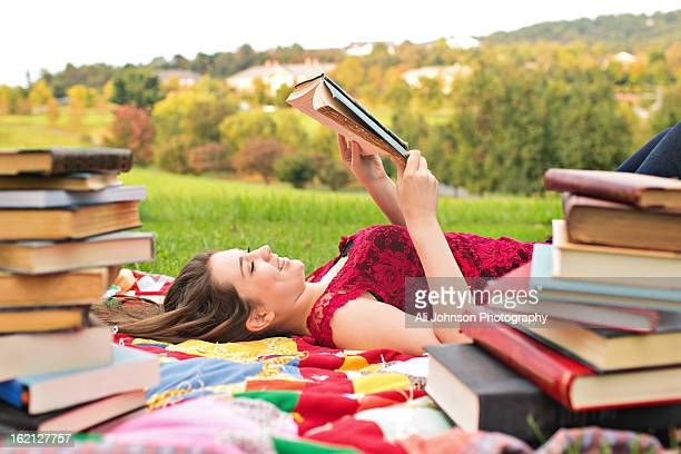 Teenage girl surrounded by books