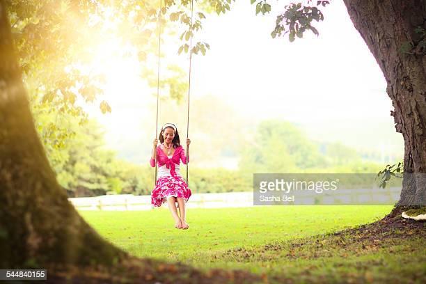 Teenage Girl Swinging in the Sunshine