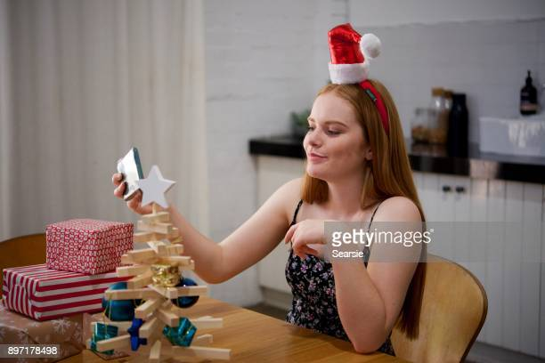 Teenage girl taking a selfie at Christmas