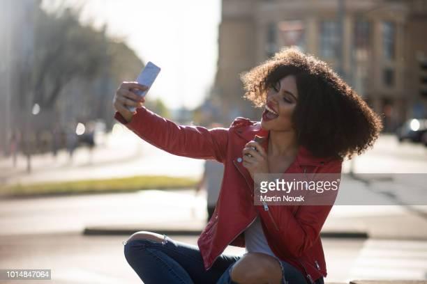 Teenage girl taking chocolate selfie