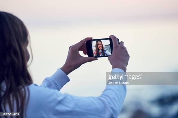 Teenage girl taking selfie