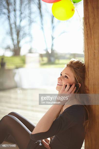Teenage girl talking on mobile at birthday party