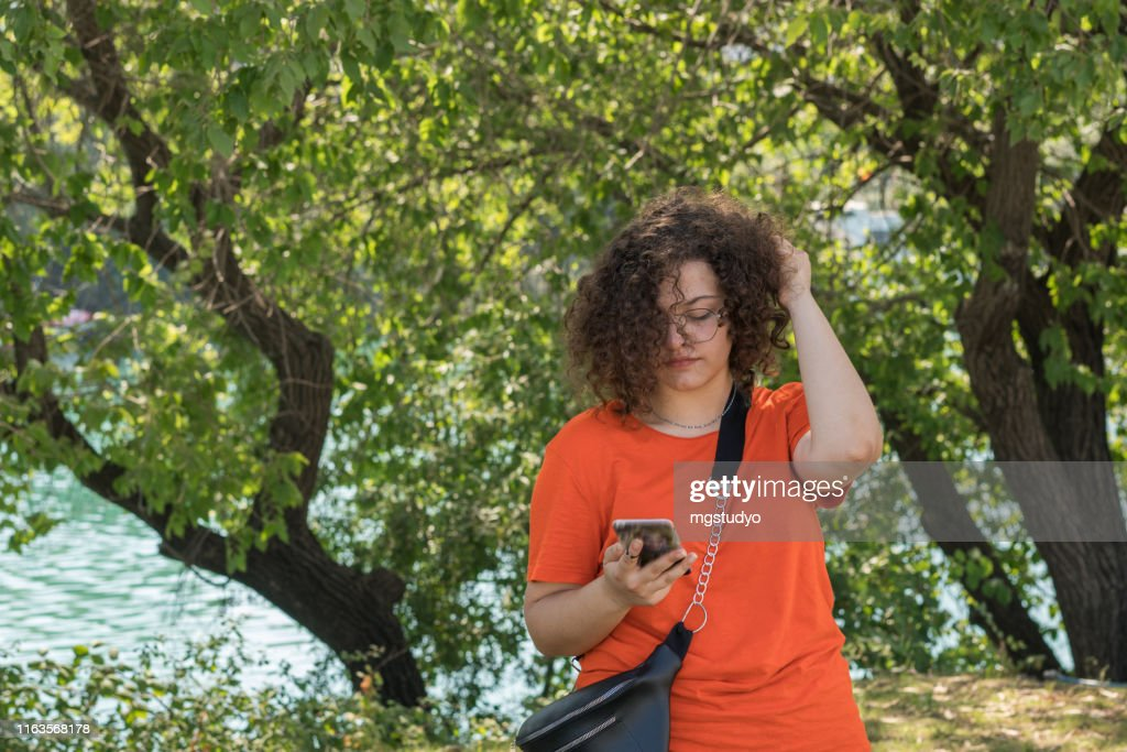 Teenage girl talking on phone : Stock Photo