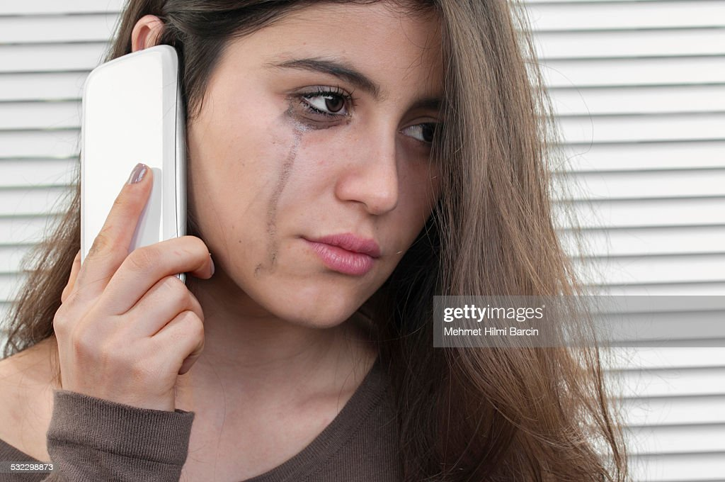 Teenage girl talking with mobile phone in depression : Stock Photo