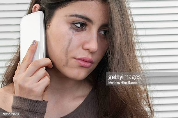Teenage girl talking with mobile phone in depression