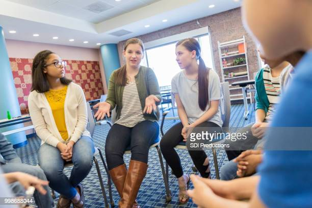 teenage girl talks during support group meeting - teenagers only stock pictures, royalty-free photos & images