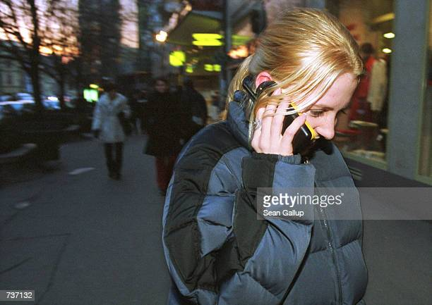 A teenage girl talks on her GSM mobile phone January 26 2001 in central Prague Czech Republic The number of mobile lines recently outnumbered the...