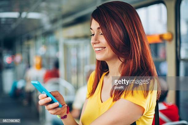 Teenage girl texting in the metro