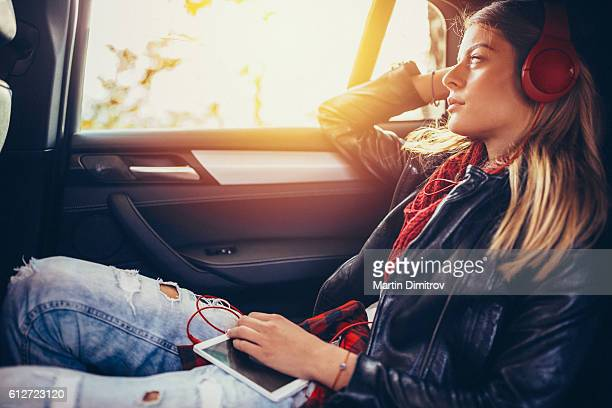 Teenage girl traveling with car