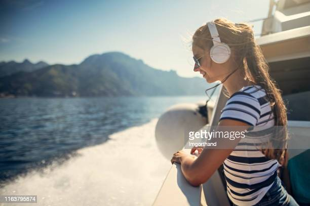 teenage girl travelling by boat near amalfi coast, italy - passenger craft stock pictures, royalty-free photos & images