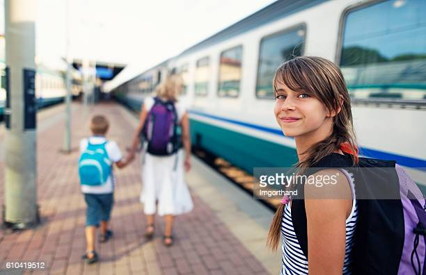 Teenage girl travelling by train in Italy