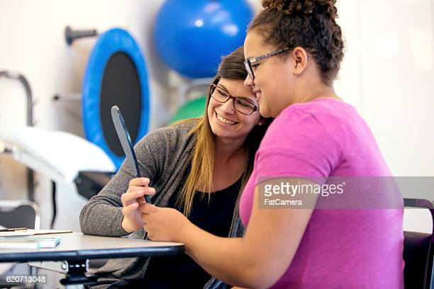 Teenage girl using a mirror for speech therapy