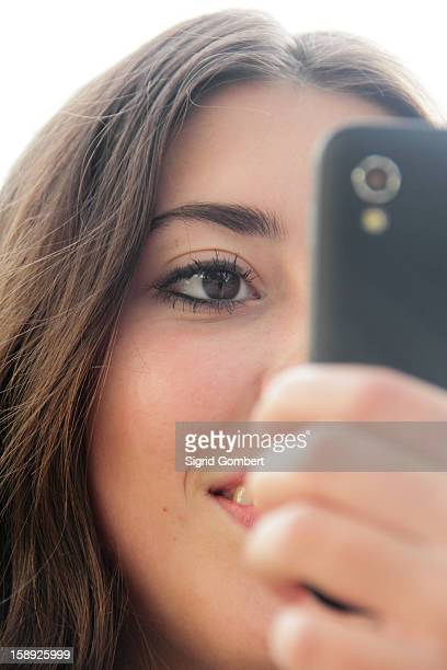 teenage girl using cell phone outdoors - sigrid gombert stock pictures, royalty-free photos & images